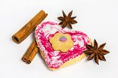 Heart Shaped Cookie Decorated With Cinnamon And Star Anise Isolated On White