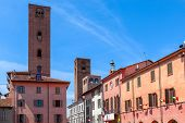 Medieval towers and buildings in old town of Alba, Piedmont, Northern Italy.