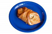 image of ruddy-faced  - croissant with apples on a blue plate insulation - JPG