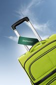 Destination. Green Suitcase With Label