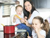 A family cook pasta inside the kitchen