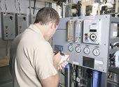 foto of air compressor  - A Air Conditioner Repair Man at work - JPG