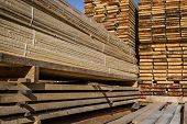 foto of timber  - Stacked wood pine timber for furniture production and construction - JPG