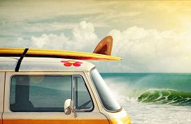 pic of fin  - Idyllic surfing way of life with a van and long board near the sea - JPG
