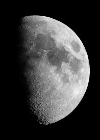 stock photo of half  - Half moon in the sky taken with a small telescope - JPG