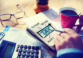 stock photo of economy  - Businessman Tax Economy Refund Money Concept - JPG