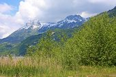 picture of annecy  - snow on the mountains by Lake Annecy in spring - JPG