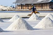 pic of salt mine  - Farmers are harvesting salt in the salt fields south of Thailand.