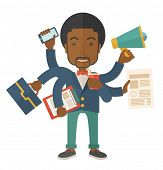 stock photo of multitasking  - A young but happy african employee has six arms doing multiple office tasks at once as a symbol of the ability to multitask - JPG