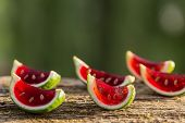 image of jello  - Strawberry jello served in lime shells on wooden table - JPG