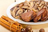 foto of deer meat  - venison deer game filet tenderloin and fresh wild mushrooms - JPG