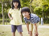 stock photo of japan girl  - little asian boy and girl playing outdoors - JPG