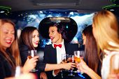 stock photo of hen party  - group of happy elegant women clinking glasses in limousine hen party - JPG