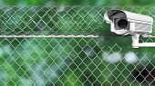 pic of chain link fence  - Security surveillance camera on chain - JPG