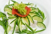 pic of cucumber  - vegetable salad with cucumbers lettuce tomatoes and cheese of original decorated - JPG