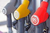 stock photo of petrol  - Petrol Pump Filling  refueling nozzle at a gas station - JPG