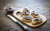image of baguette  - Slices Of Baguette With Chocolate Cream On The Wooden Board - JPG