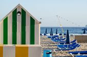 pic of beach hut  - Beach hut and deckchairs on sunny Benidorm beach Costa Blanca Spain - JPG