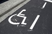 stock photo of disability  - Parking place reserved for disabled people - JPG