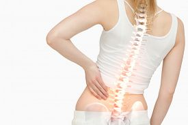 stock photo of spine  - Digital composite of Highlighted spine of woman with back pain - JPG
