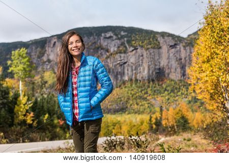 Autumn nature lifestyle happy Asian woman relaxing outdoors on camping travel park with mountain bac