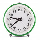 Green clock over white