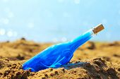 Blue bottle in sand