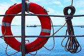 Red bouy on ship with rope