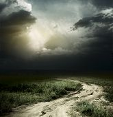 image of dark side  - Rural road and dark storm clouds - JPG