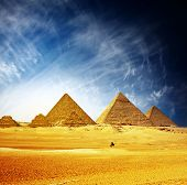 stock photo of pharaohs  - Great pyramids in Giza valley and rider on camel - JPG
