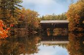 image of covered bridge  - covered bridge in Maine during fall colors - JPG
