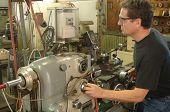 Machinist working a metal lathe