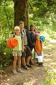stock photo of sleeping bag  - Group of kids with camping gear - JPG