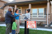 Realtor gives family keys to new home