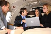 Group of businesspeople meeting in private jet