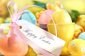 Festive decorations and eggs with card that reads Happy Easter
