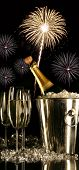 image of christmas party  - Glasses of champagne with fireworks on black background - JPG