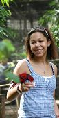 Biracial Young Woman Feeding A Bird