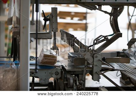 poster of Industrial Line For Packaging Of Bakery Products. Packing Of Bread At The Factory.the Machine For Cu