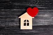 Wooden House With A Red Heart On A Background Of Black Wooden Boards. A Notification Icon For The Ap poster