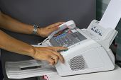 Hand Man Are Using A Fax Machine In The Office. Business Concept poster