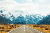 Road travel in the green mountains of New Zealand view from car window. Scenic peaks and ridges. Bea poster