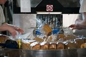 Industrial Line For Packaging Of Bakery Products. Packing Of Bread At The Factory.the Machine For Cu poster