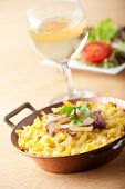 picture of glass noodles  - bavarian spaetzle noodles with cheese and wine