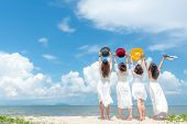 Smiling Group Woman Wearing Fashion White Dress Summer Walking On The Sandy Ocean Beach, Beautiful B poster