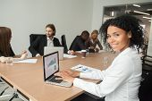 Smiling Millennial African Businesswoman Looking At Camera At Meeting, Female Afro American Marketin poster