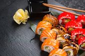 Sushi with chopsticks and soy sauce. Sushi roll japanese food in restaurant. California Sushi roll s poster