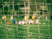 Hang Bended White Black Soccer Nets Soccer Football Net. Grass On Football Playground In The Backgro poster