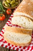 Fresh Italian Ciabatta Bread Sliced, Cherry Tomatoes And Green Olives On The Side (selective Focus,  poster