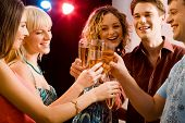 image of night-club  - Portrait of five happy people holding glasses of champagne making a toast - JPG